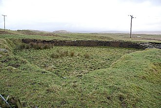 Buddle pit - A large buddle pit at Mulreesh, one of the historic lead mining areas of Islay. A buddle pit was used to concentrate the heavier plumbiferous ores from the lighter rocks by washing.