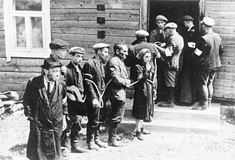 German occupation of Lithuania during World War II - Lithuanian collaborators (with white armbands) arresting the Jews in July 1941