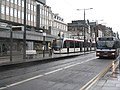 Bus and tram on Princes Street (geograph 3863744).jpg