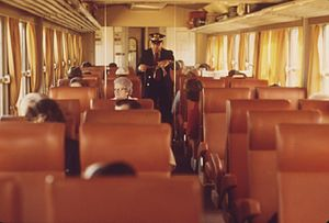 A conductor collects tickets aboard a Midwestern Turboliner in 1974
