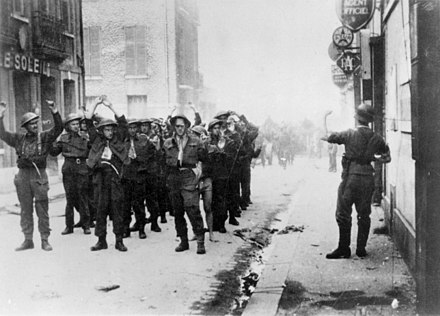 Canadian prisoners being led away through Dieppe after the raid. Credit: Library and Archives Canada / C-014171 Canadian POWs, Dieppe.jpg