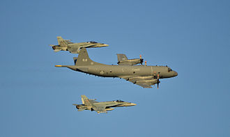 Royal Canadian Navy - A CP-140 Aurora escorted by a pair of CF-18 Hornets in 2012.
