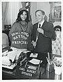 Carl Albert posing with Seminole Nation Princess behind his desk.jpg