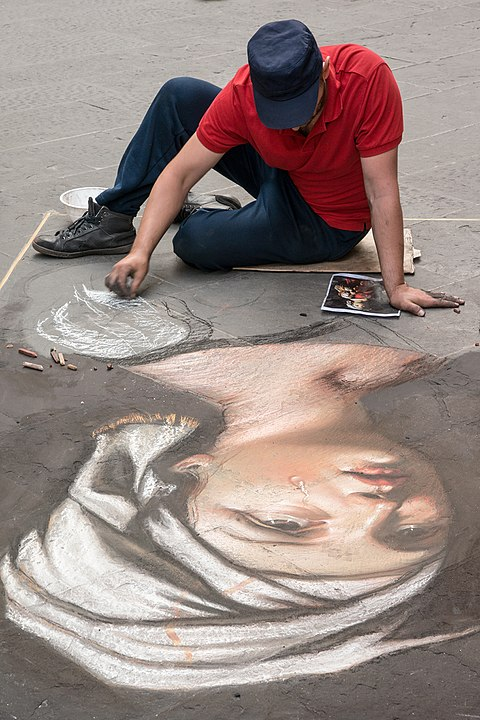 Chalk artist on street Florence Italy