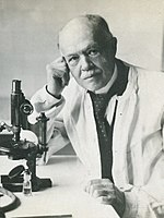 Charles Nicolle at microscope (cropped).jpg
