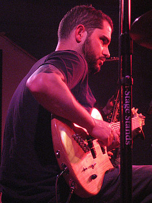 Charlie Hunter plays the song's bass and guita...