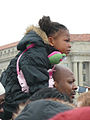 Child on fathers shoulders at Inauguration 2013.jpg
