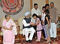 Children tying 'Rakhi' to the Prime Minister, Dr. Manmohan Singh, on the occasion of 'Raksha Bandhan', in New Delhi on August 24, 2010.jpg