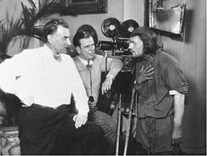 Merritt B. Gerstad - L-R: Benjamin Christensen, Merritt B. Gerstad and Lon Chaney on set of Mockery (1927)