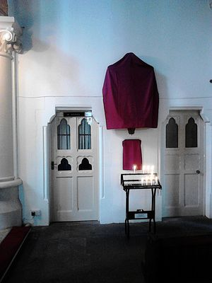 Sacrament of Penance - Functional 19th century confessionals in St Pancras Church, Ipswich. Note the veiled crucifix, indicating that it is Passiontide.