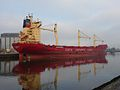 Container ship next to the Riverside stadium, Middlesborough, UK.jpg