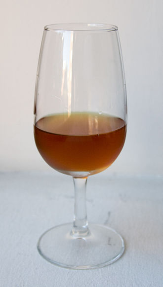 History of Sherry - A glass of Amontillado sherry.