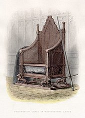 High-backed gothic chair with the Stone of Scone placed into a cavity under the seat and a sword and shield resting on each arm at Westminster Abbey.