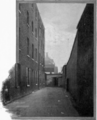 Courtyard of the former Marshalsea prison, 1897 (1).png
