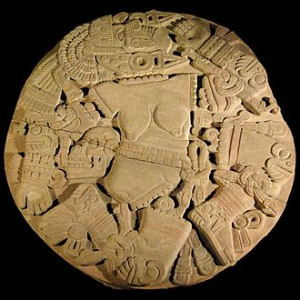 Dismemberment - Aztec stone disk depicting a dismembered Coyolxauhqui which was found during construction in 1978 in Mexico City. Its discovery led to the excavation of the Templo Mayor.