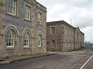 Pembroke Dock - Former dockyard buildings: offices ('Sunderland House', left) and storehouse (right)