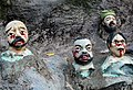 Decapitated heads, Haw Par Villa (14607375018).jpg