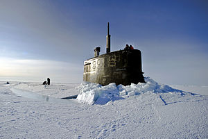 Defense.gov News Photo 110319-N-UH963-293 - U.S. Navy sailors and members of the Applied Physics Laboratory Ice Station clear ice from the hatch of the USS Connecticut SSN 22 as it surfaces.jpg