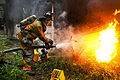 Defense.gov News Photo 110827-A-XXXXS-002 - Army Pvt. 1st Class Lucas Ternell puts out a small debris fire in a yard in Salisbury Md. on Aug. 27 2011. Ternell is a volunteer firefighter.jpg