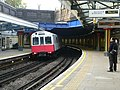 District Line D-stock train departs Bow Road westbound 2005-12-10 02.jpg