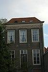 foto van Koetshuis van een der patriciershuizen aan de groenmarkt