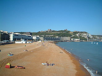 History of Dover - Dover seafront, with the castle overlooking the beach and the valley of the River Dour, behind the line of buildings