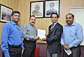 Dr. Jitendra Singh receiving RTGS transfer letter of Rs. 25 lakh donated for flood relief in Jammu & Kashmir by the Price waterhouse Coopers (PwC) India Foundation.jpg