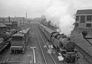 Caledonian Railway lines to Edinburgh - An empty stock train for Princes Street Station, passing Dalry Road Locomotive Depot in 1962