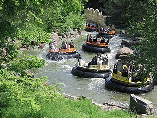 River rapids ride amusement ride that simulates whitewater rafting