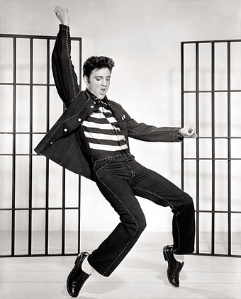 Elvis Presley helped popularise rock and roll music. Elvis Presley Jailhouse Rock.jpg