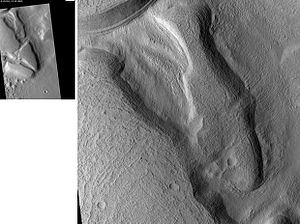 Diacria quadrangle - Erebus Montes, as seen by HiRISE. Grooves indicate movement.