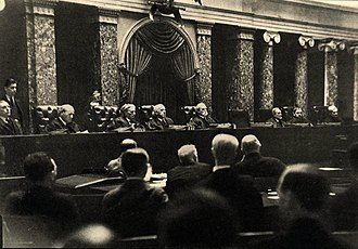 "Supreme Court of the United States - The Hughes Court in 1937, photographed by Erich Salomon. Members include Chief Justice Charles Evans Hughes (center), Louis Brandeis, Benjamin N. Cardozo, Harlan Stone, Owen Roberts, and the ""Four Horsemen"" Pierce Butler, James Clark McReynolds, George Sutherland, and Willis Van Devanter, who opposed New Deal policies."
