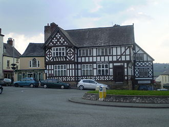 Ruthin - Exmewe Hall, on St Peter's Square, is now Barclays Bank. Despite appearances, it was reconstructed entirely in the 20th century from modern materials