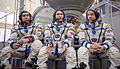 Expedition 43 backup crew members in front of the Soyuz TMA spacecraft mock-up in Star City, Russia.jpg