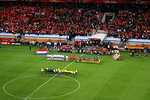 2010 FIFA World Cup Group E - The Netherlands and Cameroon teams line up prior to the game.