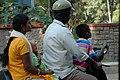 Family on Scooter, Bangalore, India (1628832960).jpg