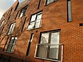 Flats or apartments on Great Western Street in Moss Side, Manchester - panoramio.jpg