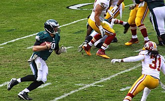 Nick Foles - Nick Foles during a four-yard touchdown run during a 24–16 victory over the Redskins on November 17, 2013.