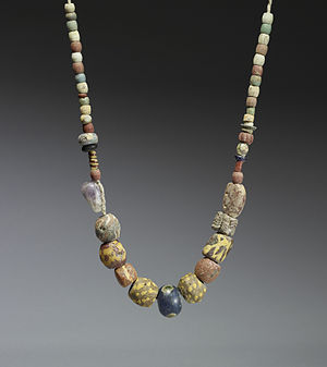 A 6th-7th century necklace of glass and ceramic beads with a central amethyst bead. Similar necklaces have been found in the graves of Frankish women in the Rhineland. Frankish - Necklace - Walters 47596 - View A.jpg
