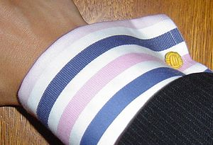 A french cuff tied with a silk knot.