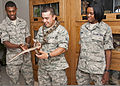 From left, U.S. Air Force Airmen 1st Class Lennell Day, Ponce Carrillo and Aane Tucker, all with the 366th Training Squadron, observe a Great Plains rat snake to practice gentle handling and to overcome the fear 110725-F-NS900-004.jpg