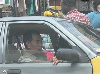 Chinese people in Ghana - Ghanaian Chinese Taxicab driver in Ghana.