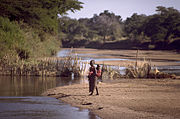 Girls crossing a river (Zambia)