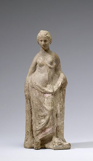 Tanagra figurine - This terracotta figurine of a woman demonstrates some thematic elements that are common to these statuettes. Walters Art Museum, Baltimore.