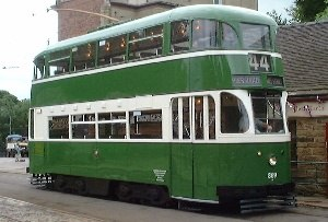 National Tramway Museum - A 1936 Liverpool streamlined tram outside the reconstructed Derby Assembly Rooms at Crich Town End