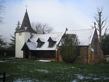 Greensted Church is believed by many to be the oldest wooden church in the world. The east end, of brick construction, dates from the sixteenth century, while the brick footings, visible below the timber walls, are a feature of extensive restoration undertaken in the nineteenth century.