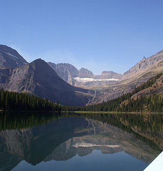 George Bird Grinnell - The Salamander Glacier and Lake Josephine, Glacier National Park.  The Salamander used to be part of Grinnell Glacier but was named in the mid-20th century after Grinnell dwindled and split in two.  Lying immediately beneath the Salamander, Grinnell Glacier is not visible in this photograph.