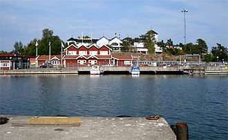 Grisslehamn - Grisslehamns harbour, with the ferry terminal (the red building) and Hotell Havsbaden (the white building behind).