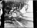 Group of women and children sitting on large tree branch on shore of Lake Washington, 1900 (SEATTLE 4608).jpg