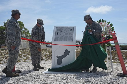 US Air Force Captain Allen Jaime, commander of Wake Island, unveils the new Guam Memorial on June 8, 2017. The memorial honors 45 Chamorros from Guam who worked for Pan American Airlines and were on the island when the Japanese attacked on December 8, 1941. 10 of the men were killed during the attack and the remaining 35 were sent to prison camps in Japan and China. Guam Memorial on Wake Island.jpg